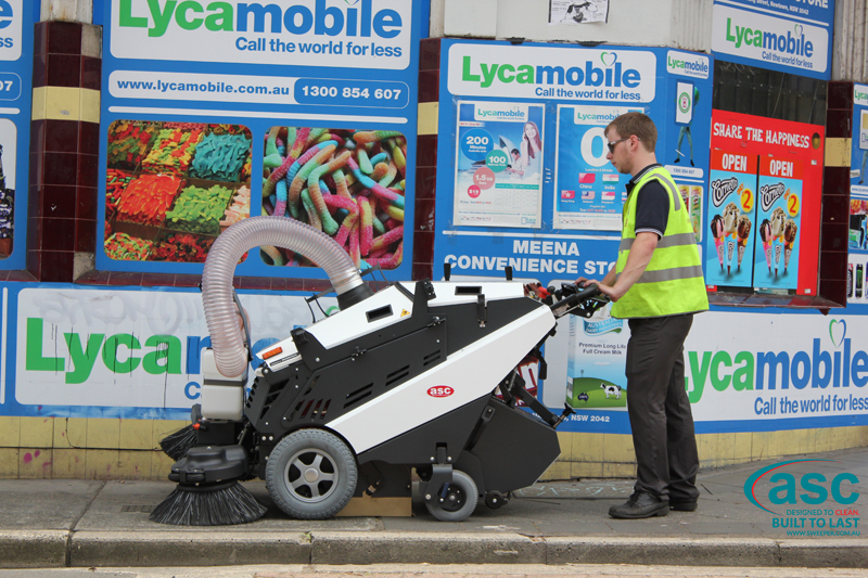ASC 125 Sweeper with man 1