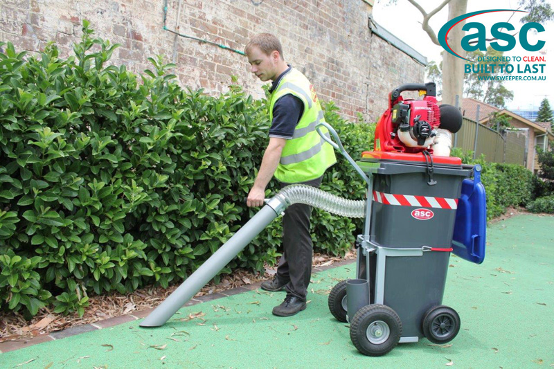 ASC BIN VAC 250 Push Sweeper with man 11