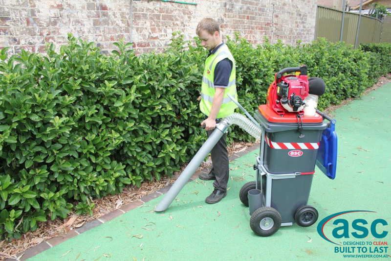 ASC BIN VAC 250 Push Sweeper with man 12