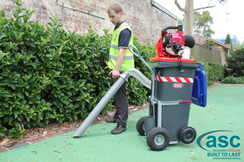 ASC BIN VAC 250 Push Sweeper with man 14