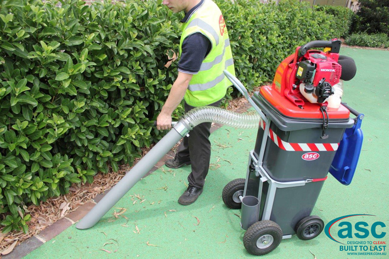 ASC BIN VAC 250 Push Sweeper with man 15