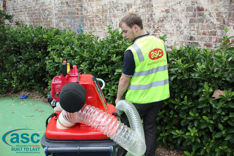 ASC BIN VAC 250 Push Sweeper with man 2