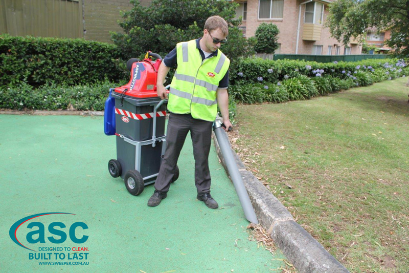 ASC BIN VAC 250 Push Sweeper with man 3