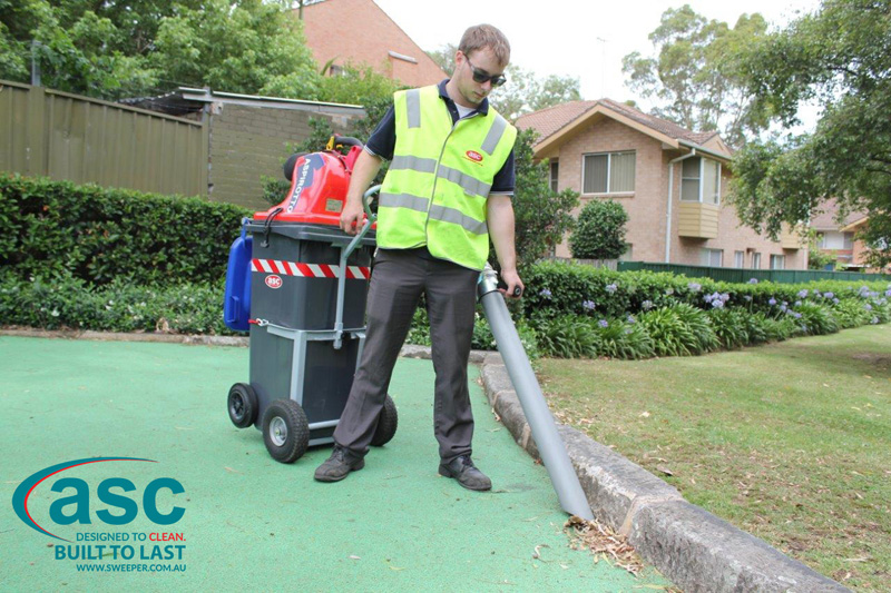 ASC BIN VAC 250 Push Sweeper with man 4