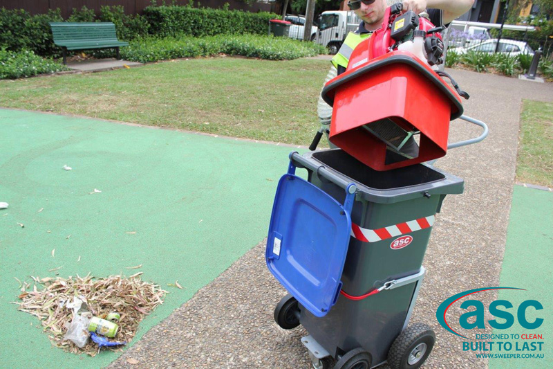 ASC BIN VAC 250 Push Sweeper with man 6